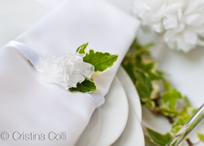romantic ivy and white pompom table setting