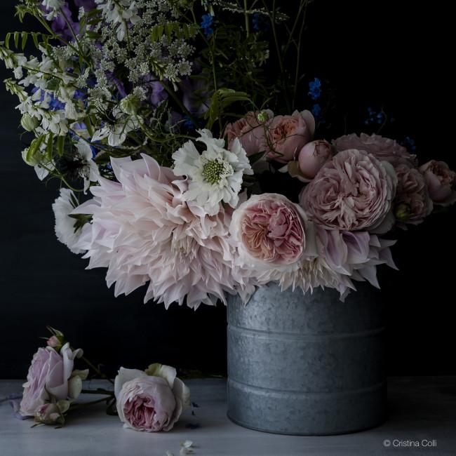 moody summer flowers in a bucket